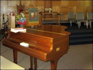 A piano accompanies hymns from VOICES UNITED & MORE VOICES and the children's hymn. The Church Choir often presents a special musical choice. Church members and their children are welcome to perform.